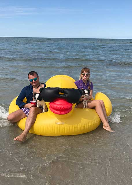 Dr. Spivak with her husband and Cleopatra beach tubing